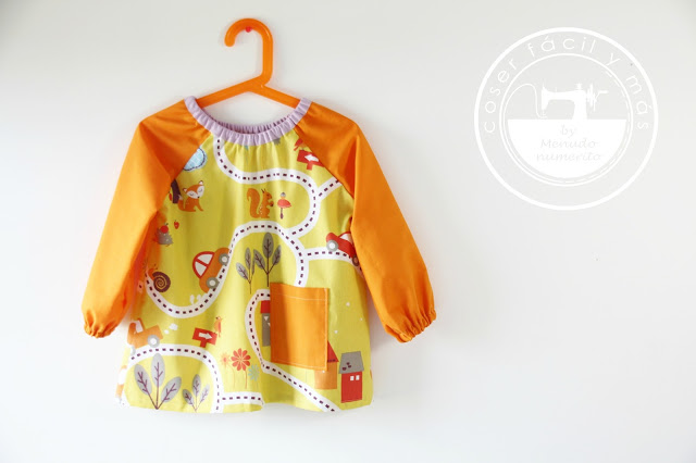 Cómo coser un babi de guardería o bata escolar para niños